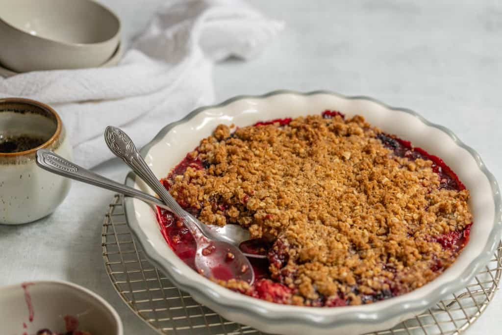 Quick and Easy Berry Crisp topped with a oat crumble